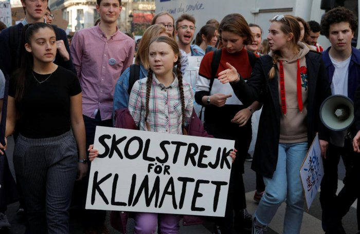 16-year-old Swedish environmental activist Greta Thunberg and Anuna De Wever, a Belgian climate student activist, take part in a protest claiming for urgent measures to combat climate change, in Paris, France, February 22, 2019. (REUTERS)