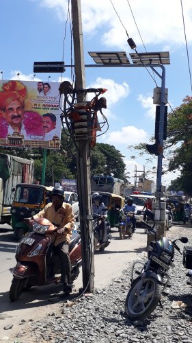 This pole in Lingararajapuramhas cables extending on to the road.