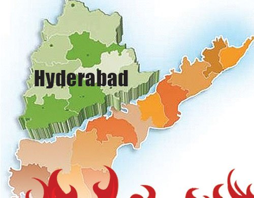 Telangana bill tabled in AP Houses amid din