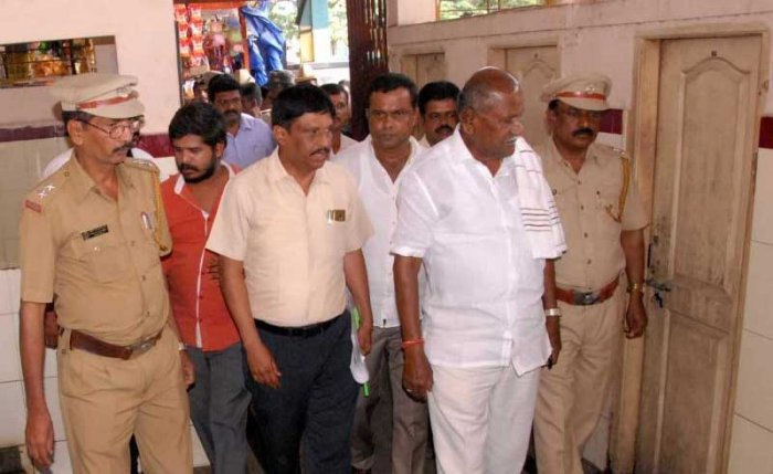 Transport Minister D C Tammanna inspect toilets in KSRTC bus stand at Chikkamagaluru on Sunday.