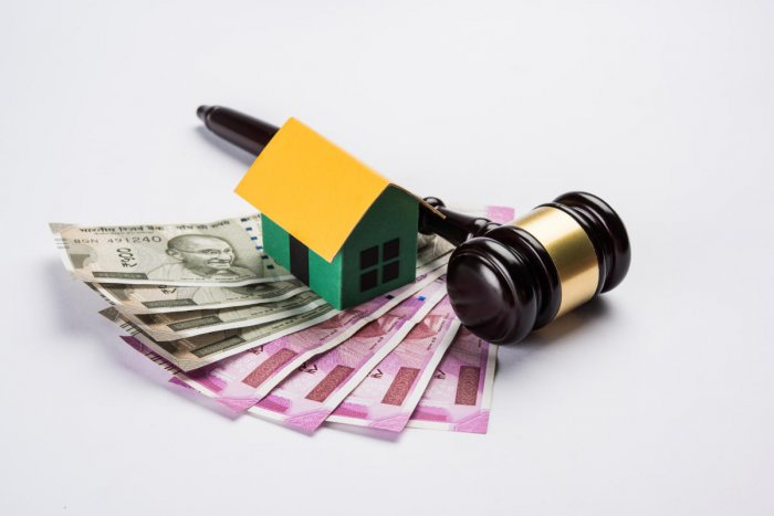 stock photo of india and real estate law, Indian law for real estate / construction company / architects / builders or buyers showing small house model, gavel / hammer, indian currency notescourt