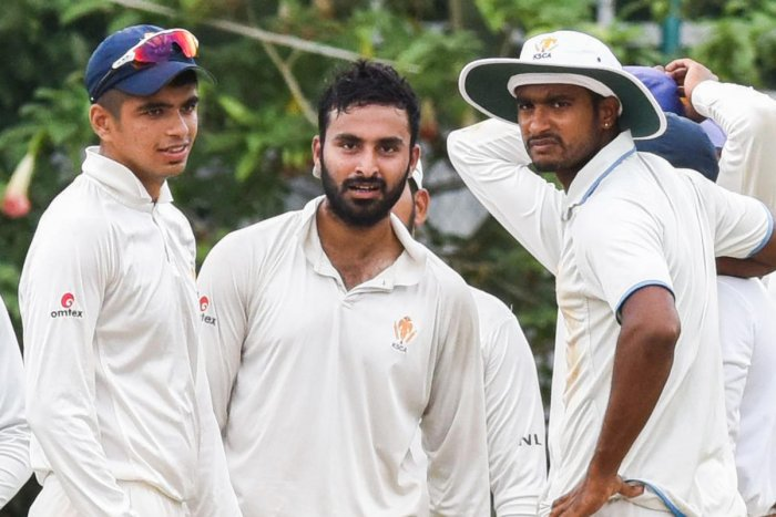 FINE EFFORT: M G Naveen (centre) and Kushal Wawani (left) of KSCA Secretary's XI celebrate after dismissing an RSPB batsman at RSI ground in Bengaluru on Thursday. DH Photo