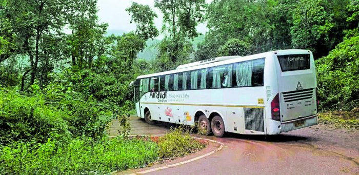 A KSRTC Volvo bus negotiating a sharp curve near Kalasa.