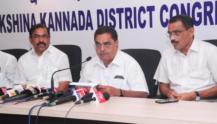 Former minister B Ramanath Rai speaks to reporters in Mangaluru on Monday.