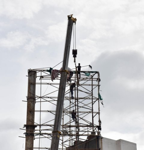 The BBMP is removing the hoardings structure on Ballery road in Bengaluru on Friday. Photo/ B H Shivakumar