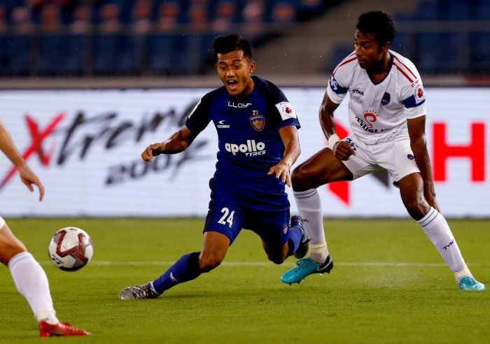 Chennaiyin FC's Isaac Vanmalsawma (left) reacts after being tackled by Delhi Dynamos FC's Rana Gharami during their match in New Delhi on Tuesday. PTI