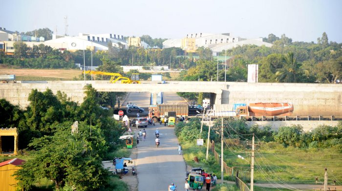 The flyover providing two underpass entries to Bengaluru International Exhibition Center under construction on Tumkur road in Bengaluru on Wednesday. DH Photo/Srikanta Sharma R.