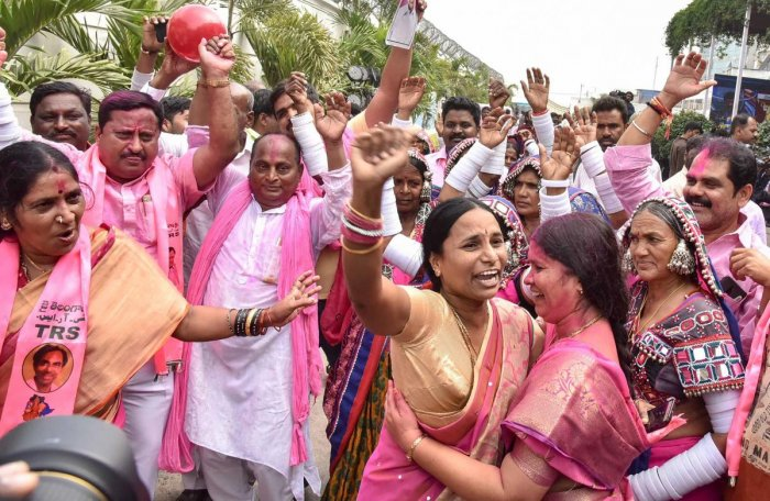 Telangana Rashtra Samithi (TRS) workers celebrate their party's victory in the states Assembly elections, at Telangana Bhavan in Hyderabad, on Tuesday. PTI