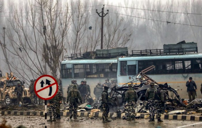 Security personnel carry out rescue and relief works at the site of a suicide bomb attack at Awantipora in Pulwama district of south Kashmir on February 14. 49 CRPF jawans were killed and dozens other injured in the attack. PTI