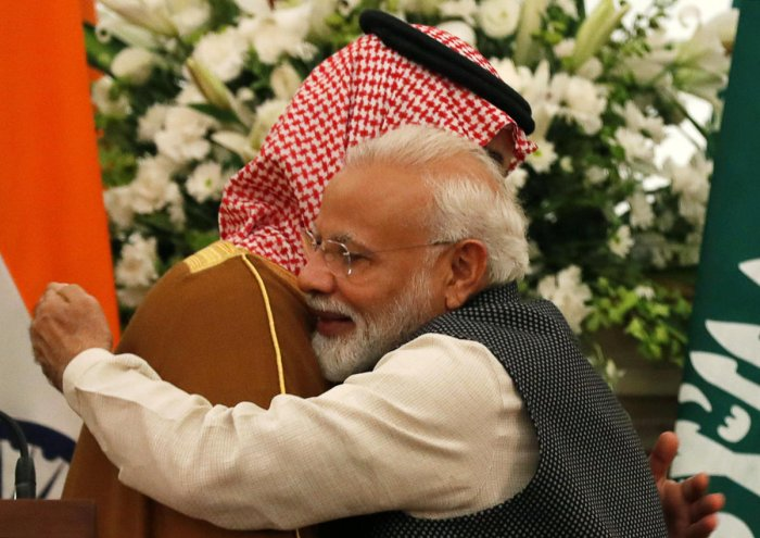 Prime Minister Narendra Modi hugs Saudi Arabia's Crown Prince Mohammed bin Salman during their meeting at Hyderabad House in New Delhi. REUTERS
