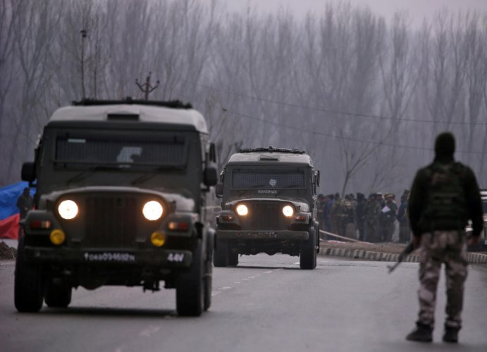 FILE: Soldiers stand guard near the site of the suicide bomb attack in Lethpora in south Kashmir's Pulwama district on February 15, 2019. REUTERS