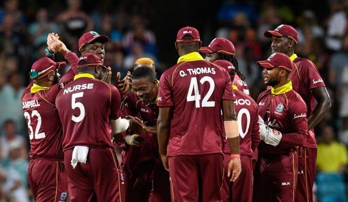 Sheldon Cottrell celebrates the dismissal of Moeen Ali during the 2nd ODI between West Indies and England at Kensington Oval, Bridgetown, Barbados. (AFP Photo)