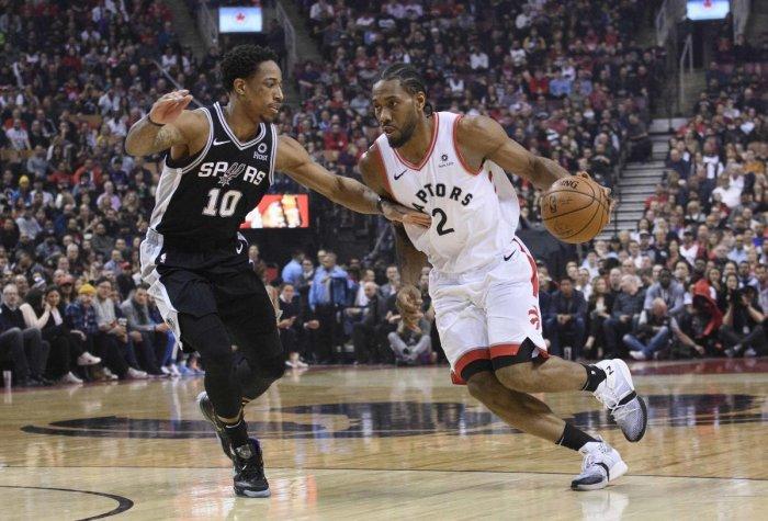 Feb 22, 2019; Toronto, Ontario, CAN; Toronto Raptors forward Kawhi Leonard (2) controls a ball as San Antonio Spurs guard DeMar DeRozan (10) defends during the first quarter at Scotiabank Arena. Mandatory Credit: Nick Turchiaro-USA TODAY Sports