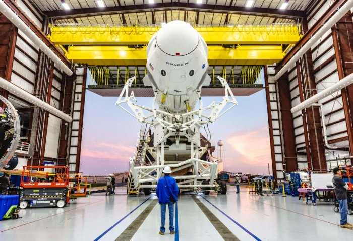 The SpaceX Falcon 9 rocket with the company's Crew Dragon attached, rolling out of the company's hangar at NASA Kennedy Space Center's Launch Complex 39A. (Photo by HO / NASA / AFP)