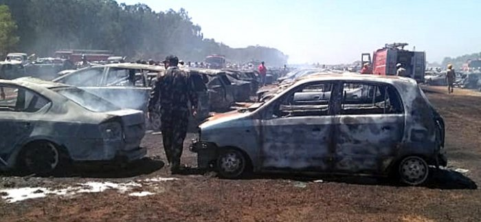 The remains of the cars after the massive fire at the parking lot of Aero India 2019 at Yelahanka airbase in Bengaluru on Saturday. DH Photo
