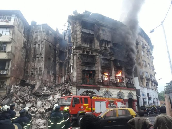 The fire brigade personnel were injured when a portion of the building, called Kothari building (also known as the Light Of Asia), collapsed during the fire-fighting operation. (DH Photo)