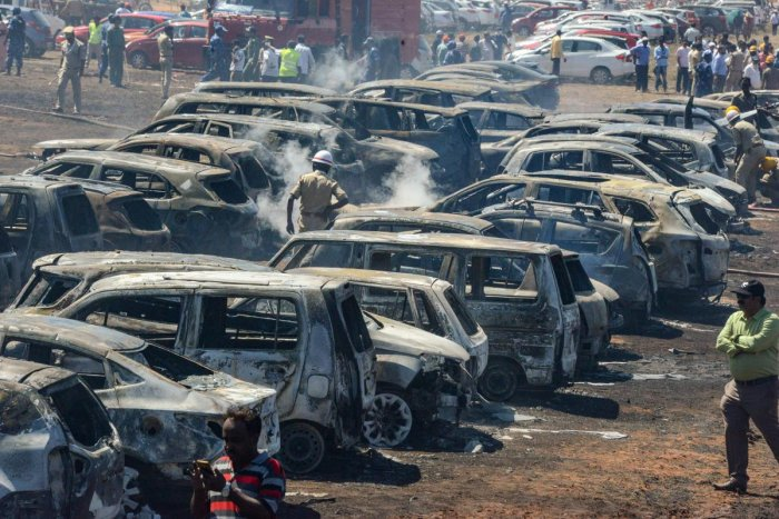 Gutted cars parking area after a massive fire on the 4th day of 12th edition of Aero India 2019, at Yelahanka Air Base in Bengaluru, on Saturday. PTI