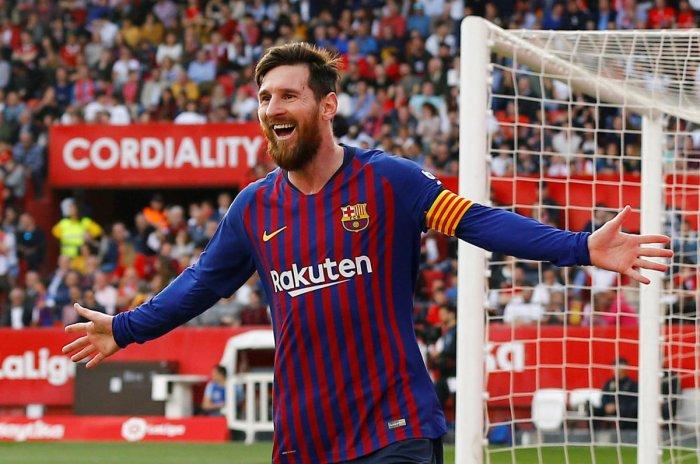 Barcelona's Lionel Messi celebrates after completing his hat-trick. REUTERS