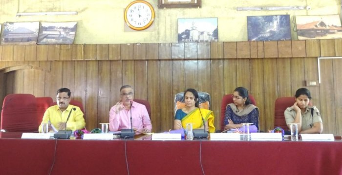 State Commissioner for Persons with Disabilities V S Basavaraju (2nd from left) addresses a meeting at Old Fort Hall in Madikeri.