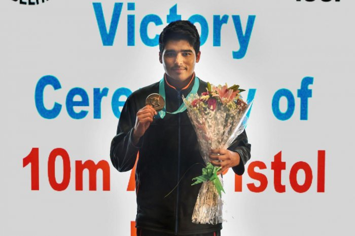 SHINING BRIGHT: India's Saurabh Chaudhary with his gold medal at the ISSF World Cup in New Delhi. PTI