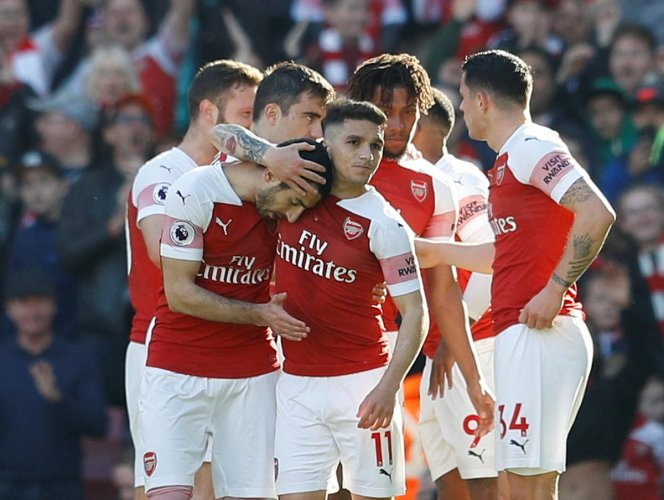 EASILY DONE: Arsenal's Henrikh Mkhitaryan (left) celebrates with team-mates after scoring their second goal against Southampton on Sunday.