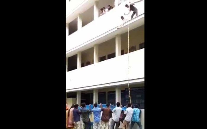 In a video clip of the incident, which had gone viral, N Logeshwari, a second-year BBA student, appears reluctant to take the jump even though a net was held by a group of students to ensure a safe landing. It showed the 31-year-old trainer pushing down Logeswari, who then hit a sunshade on the first floor. (Screengrab)