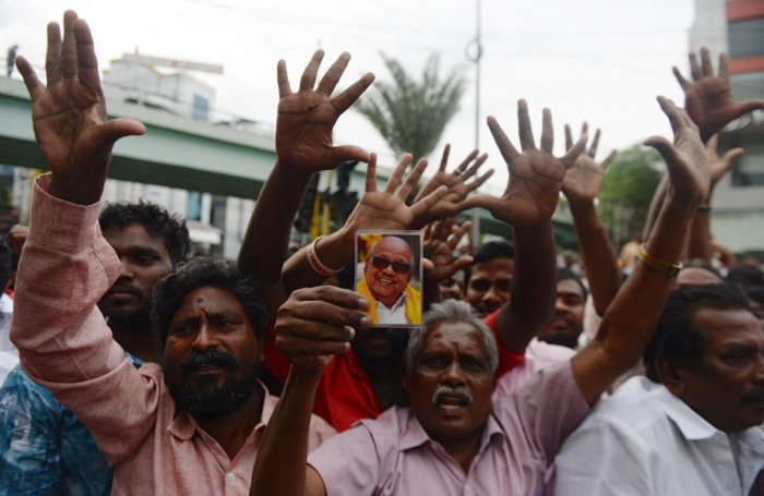 DMK supporters shout slogans in support of their leader M Karunanidhi, who is being treated for a urinary tract infection, outside Kauvery Hospital in Chennai on Saturday. (AFP)