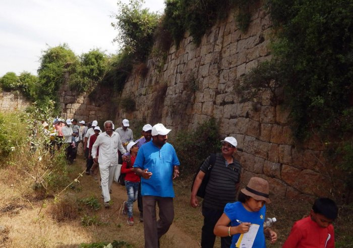 Remnants A team of tourists walking along the Srirangapatna Fort