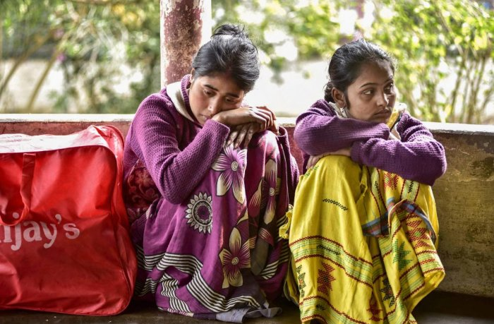 Relative of the victims, who died after consuming spurious liquor at a tea garden, wait at the hospital, in Golaghat, on February 23, 2019. At least 59 people died allegedly after the incident. PTI