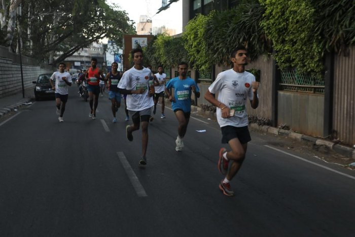 Citizens take part in Neerathon, a run to promote and advocate water conservation in the city, on Sunday.