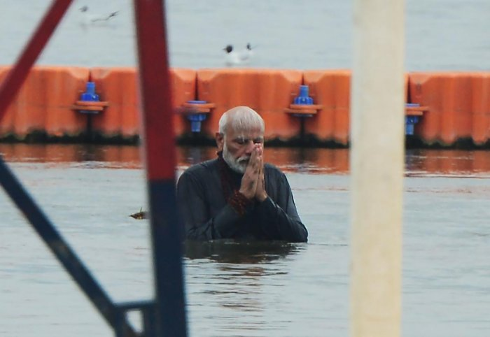 Prime Minister Narendra Modi takes a holy dip at Sangam during the Kumbh Mela festival in Allahabad on Sunday. AFP