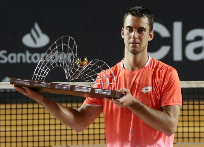 MEMORABLE DAY: Serbia's Laslo Djere with the Rio Open trophy after defeating Felix Auger-Aliassime of Canada on Sunday. REUTERS