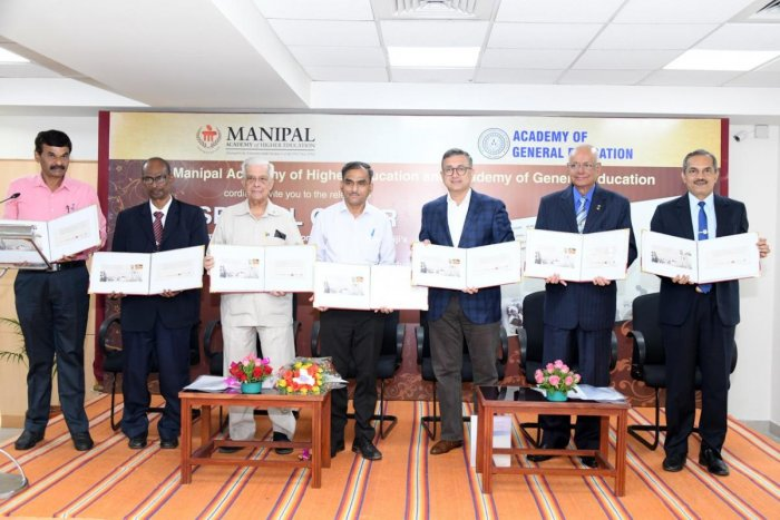 Dignitaries release a special cover on Mahatma Gandhi in Manipal on Monday.