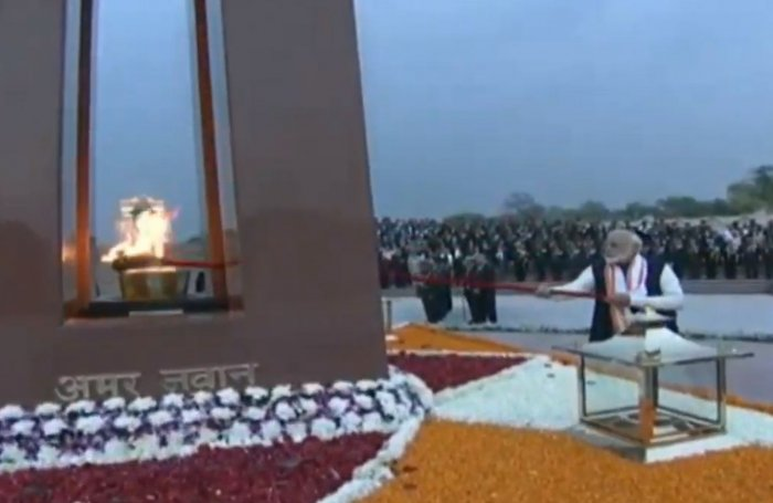 Prime Minister Naredna Modi lights the Amar Jawan Jyoti (eternal flame) in newly constructed National War Memorial in New Delhi (Video grab)