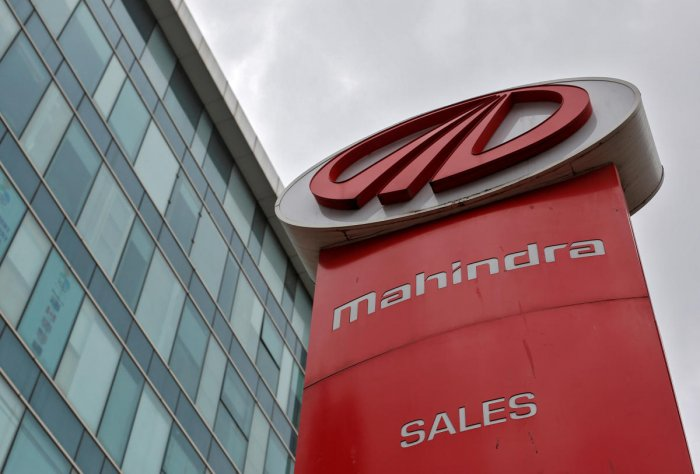 FILE PHOTO - The logo of Mahindra and Mahindra is seen at a showroom in Mumbai. REUTERS