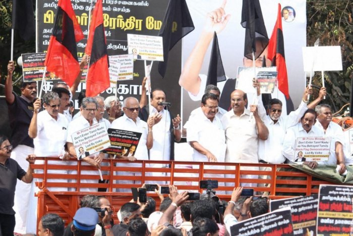 MDMK leader Vaiko with other Tamil organisation members stage a black flag to protest against Prime Minister Narendra Modi during his public meeting in Tiruppur, Tamil Nadu on Sunday. PTI