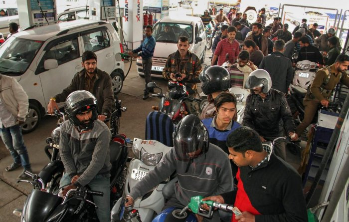 Commuters queue up at a petrol pump during a three-hour curfew relaxation for the first time since the imposition of curfew, in Jammu, on February 18, 2019. PTI