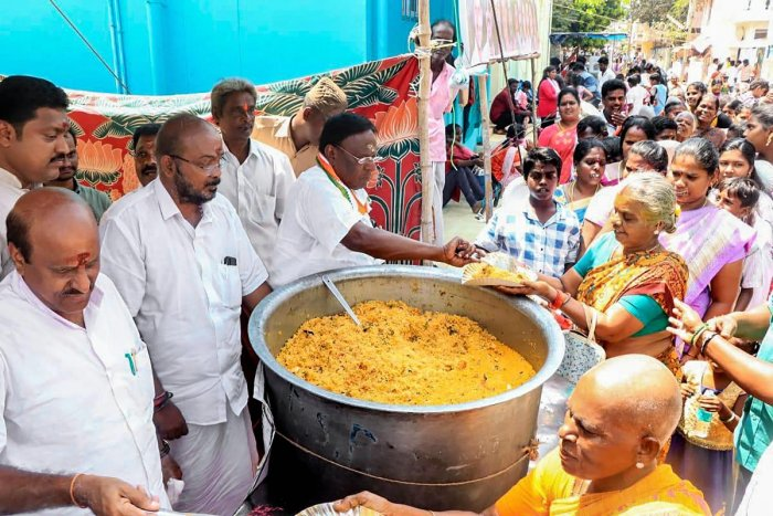 Chief Minister V Narayanasamy launches free food distribution scheme during the annual 'Maasi Magam' festival at a coastal village in Puducherry, Monday, Feb.18, 2019. (PTI Photo)