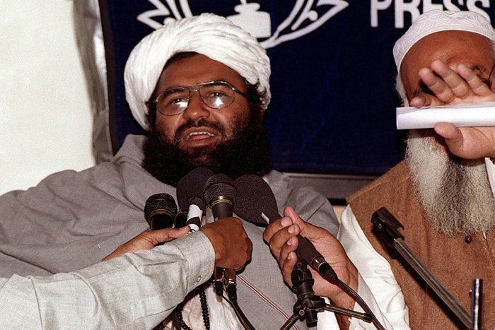 In this photograph taken on February 4, 2000, Masood Azhar (L), chief of the Jaish-e-Mohammad (JeM), addresses a press conference in Karachi. - For eight days in 1999 the world watched in horror as hijackers diverted an Indian Airlines flight to Afghanist