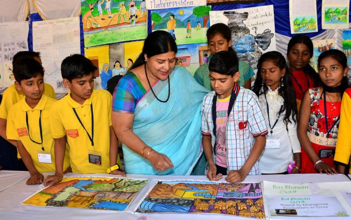 Jayamala, Minister for Women and Child Development interacts with students during the inauguration of 27th Young Environment Camp at the Bala Bhavan on Monday. DH Photo/Ranju P