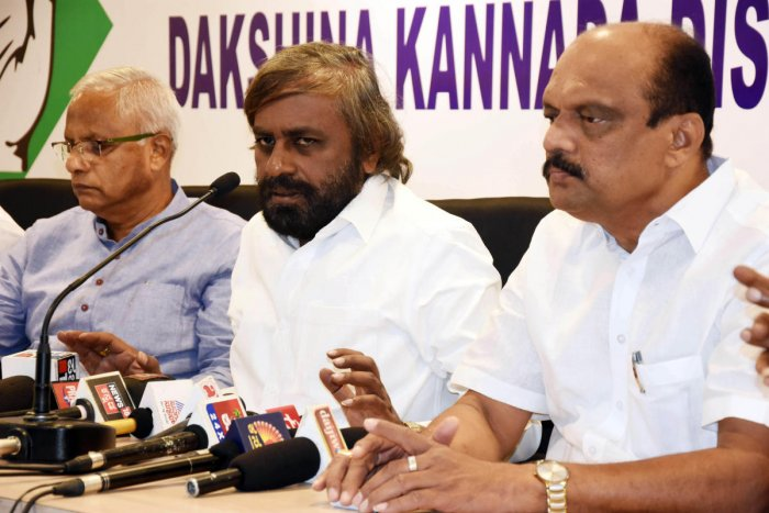 KPCC working president Eshwar Khandre speaks during a press meet at the district Congress Committee office in Mangaluru on Monday. MLC and District Congress president Harish Kumar and former MLA J R Lobo look on.