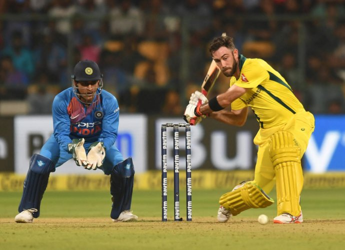 SINGING INNINGS: Australia's Glenn Maxwell coils up to send one over the fence en route his unbeaten 113 in the second T20I against India at the M Chinnaswamy Stadium in Bengaluru on Wednesday. DH Photo/ Srikanta Sharma R