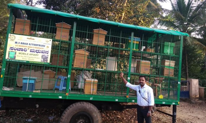 The 'Madhuvana' mobile apiary set up in a tractor trailer at the main road in Chennangolli near Gonikoppa.