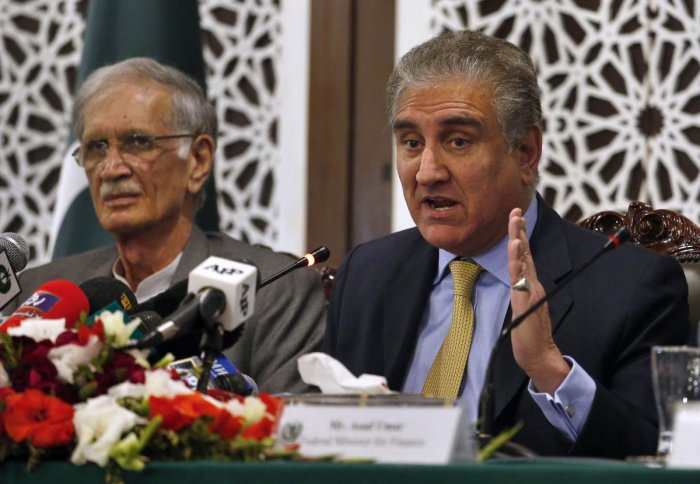 Pakistani Foreign Minister Shah Mahmood Qureshi, right, gives a press conference with Defense Minister Pervez Khattak after a recent Indian airstrike, in Islamabad, Pakistan. AP/PTI photo