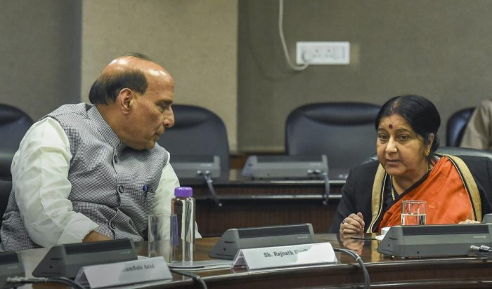 External Affairs Minister Sushma Swaraj interacts with Home Minister Rajnath Singh at an all-party meeting after IAF's pre-dawn strike on JeM camp, at Jawahar Lal Bhawan, in New Delhi. (PTI Photo)