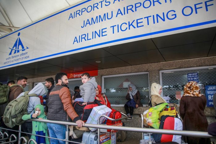 Passengers stranded outside the Jammu airport after it was closed for civilian operations amid tension along the Pakistan border. ( PTI Photo)