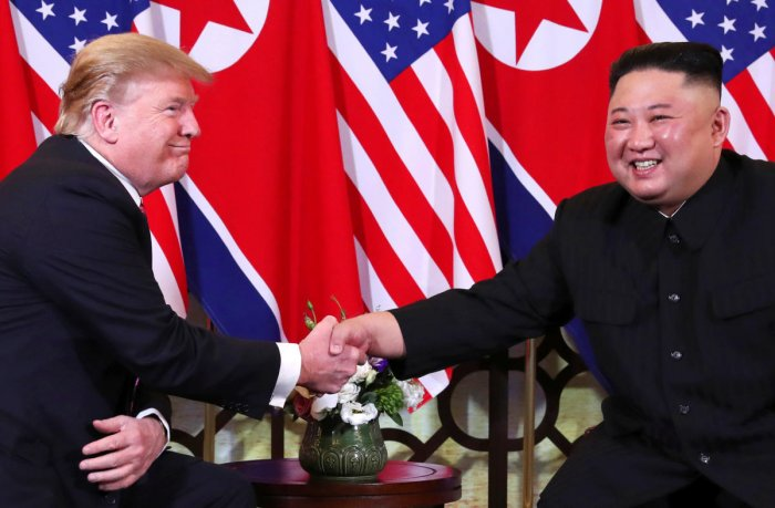 U.S. President Donald Trump and North Korean leader Kim Jong Un shake hands before their one-on-one chat during the second U.S.-North Korea summit at the Metropole Hotel in Hanoi, Vietnam. (Reuters Photo)