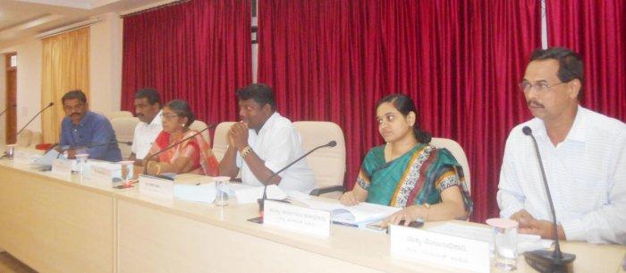 Zilla Panchayat President Dinaker Babu speaks at Karnataka Development Programme review meeting held in Udupi on Wednesday.