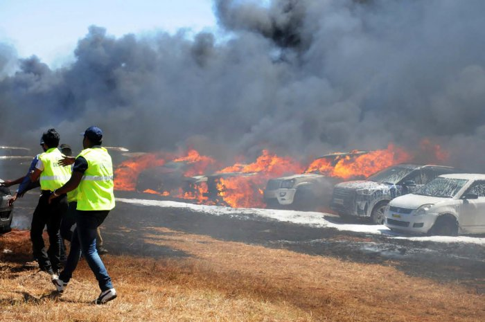 About 300 cars were gutted when a fire raged through dry grass at the Aero India parking area last Saturday.