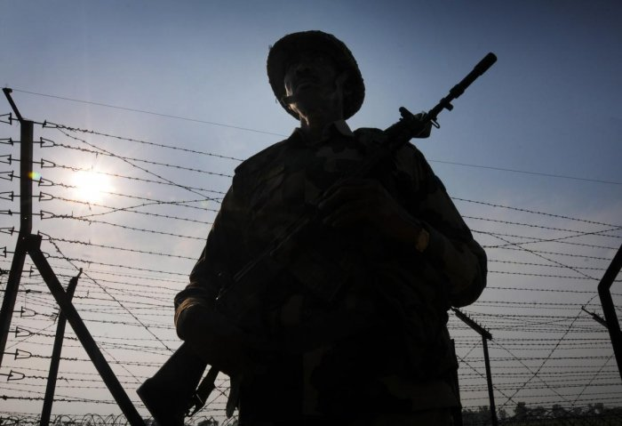 Border Security Force (BSF) personnel stand guard along the international border as security beefs up amid escalating tension between India and Pakistan, at Attari near Amritsar, Thursday. PTI photo